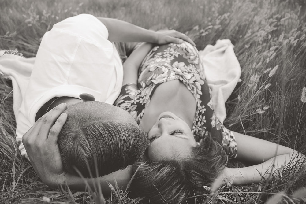 Maternity-Couple-Laying-Grass.jpg