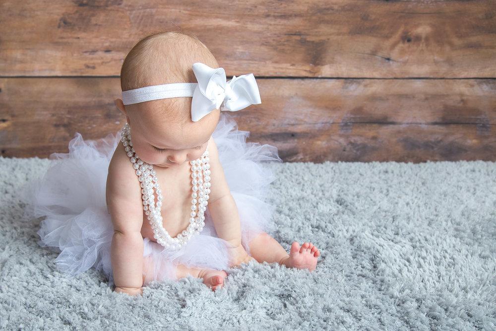 baby-girl-white-tutu-pearls-bow.jpg