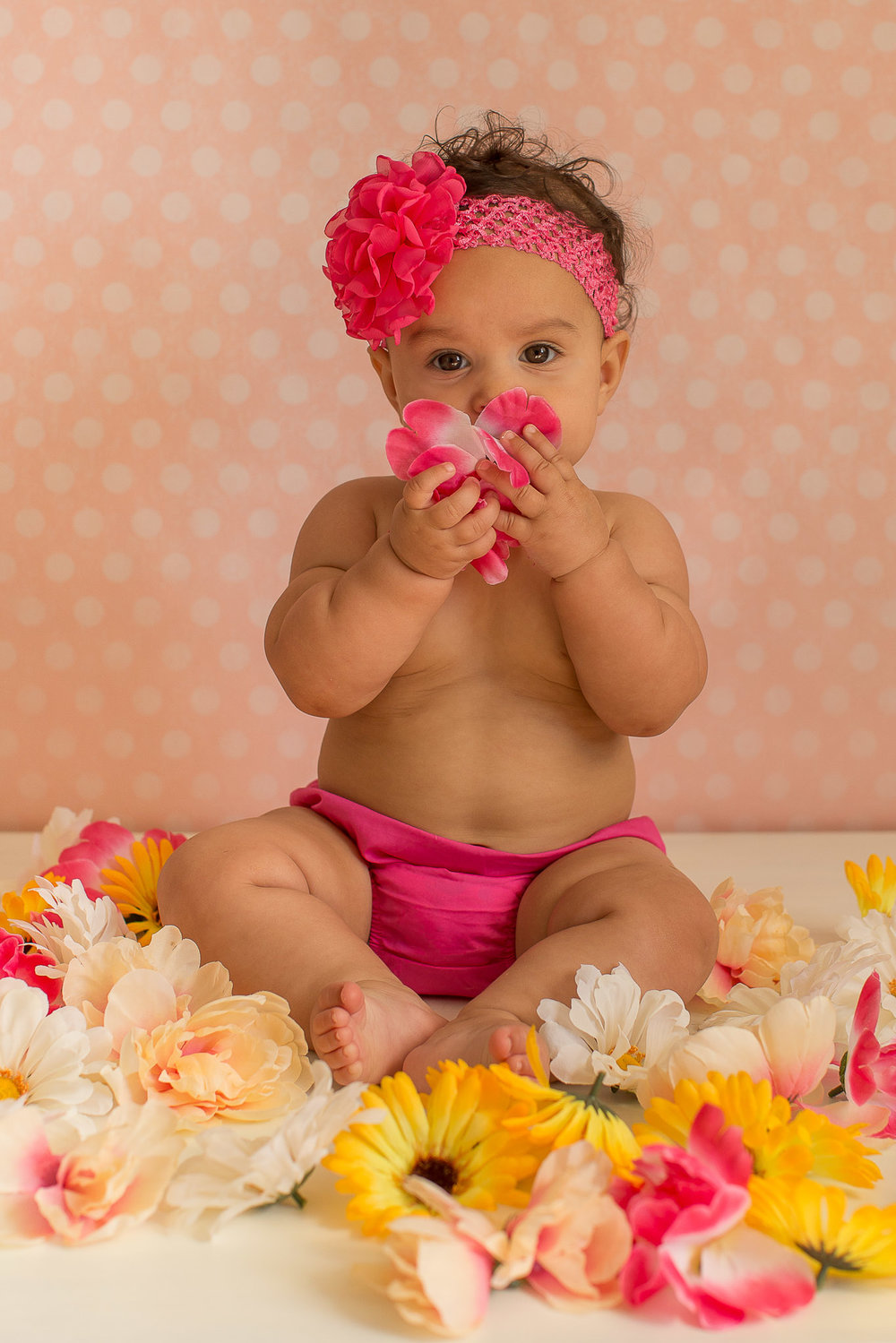 baby-girl-flowers-smelling.jpg