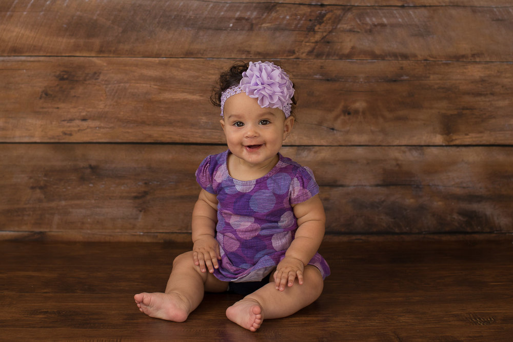 baby-girl-wood-backdrop-purple-outfit.jpg