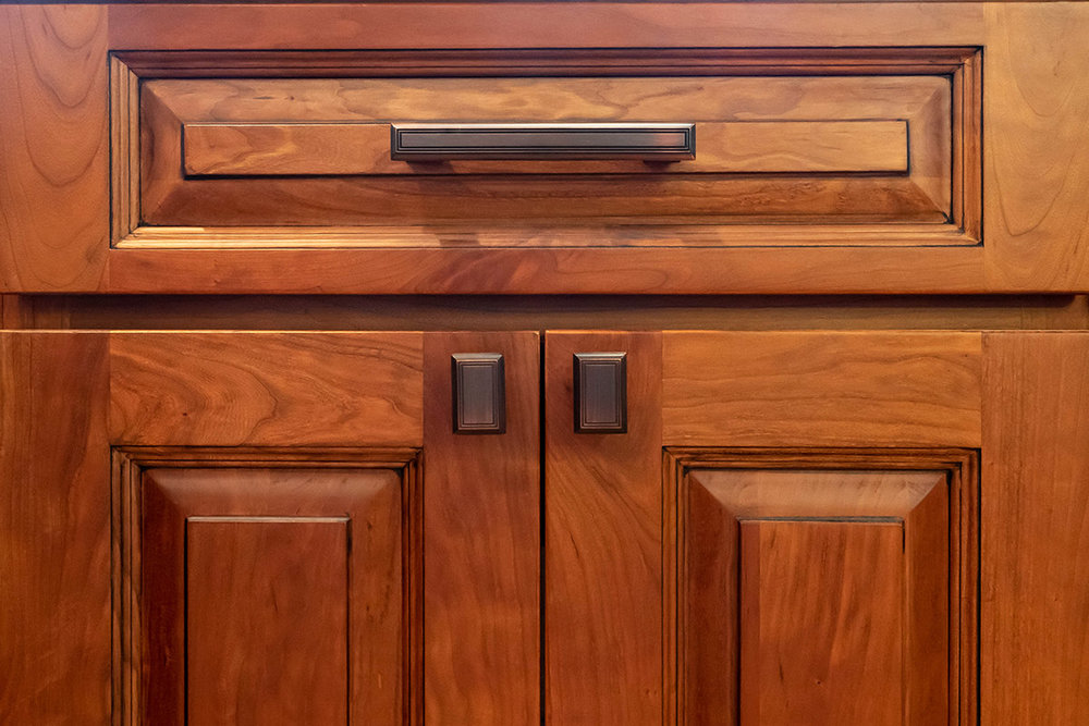 traditional-cherry-cabinets-thiemann-door.jpg