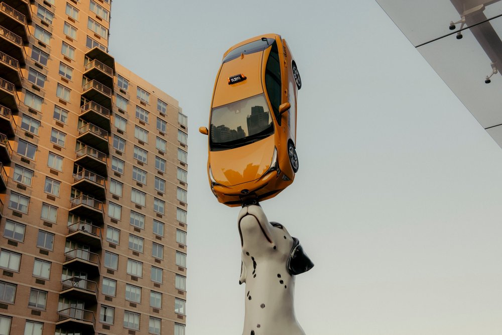 "Donald Lipski's ""Spot,"" at the Hassenfeld Children's Hospital at NYU Langone, features a 24-foot-tall Dalmatian balancing a taxi (yes, that's a real New York City cab) on its nose. Photo Credit George Etheredge for The New York Times"