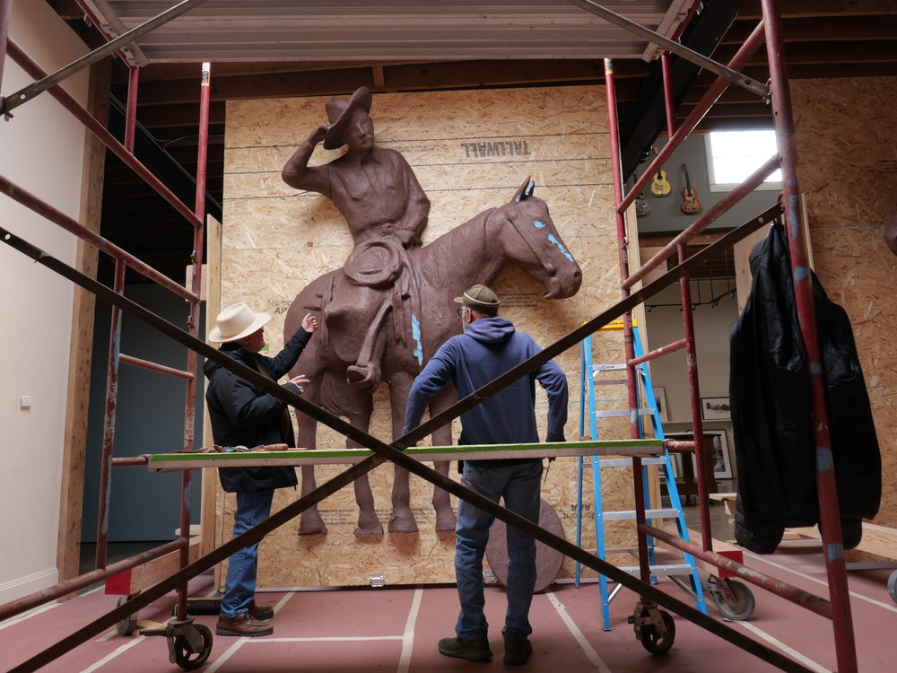 William Matthews with a 12' clay rendering for the bronze bas-relief sculpture.