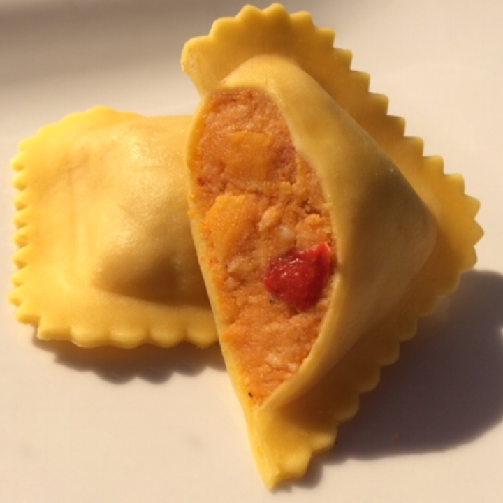 "Roasted Butternut Squash - Egg Pasta   Jumbo 3"" Square    (10-12 per lb.) - 10 lb. Bulk  First We Roast Butternut Squash to Enhance the Flavor, then we Combine it with Red Bell Pepper, Onion, Parmesan, Butter, Maple Sugar, Sage, Salt & Pepper. One of Our Best Selling Signature Ravioli!"