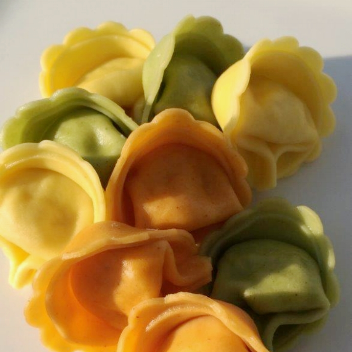 Three Cheese - Tri-Color Tortellini   10 lb. Bulk case (90-94 per lb.)  Imported Romano, Ricotta and Parmesan Cheese Blended with Fresh Parsley, Nutmeg and Black Pepper. Wrapped in our Tomato, Spinach and Egg Pasta.