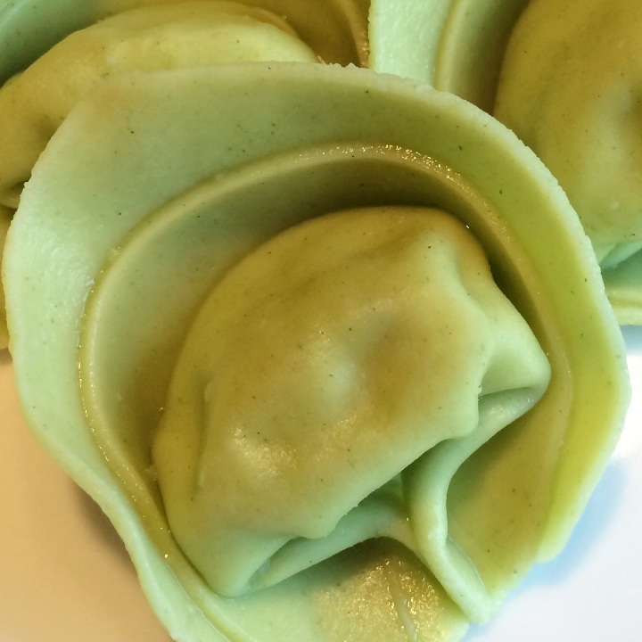 Four Cheese - Spinach Tortelloni   10 lb. Bulk case (42-45 per lb.)  Our Large Tortelloni Filled with Ricotta, Romano, Asiago and Parmesan Cheese, Parsley, Black Pepper and Nutmeg Surrounded by Our Spinach Pasta.