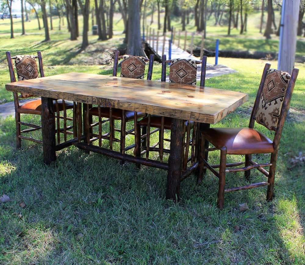 Barn wood and hickory dining table with hickory dining chairs.