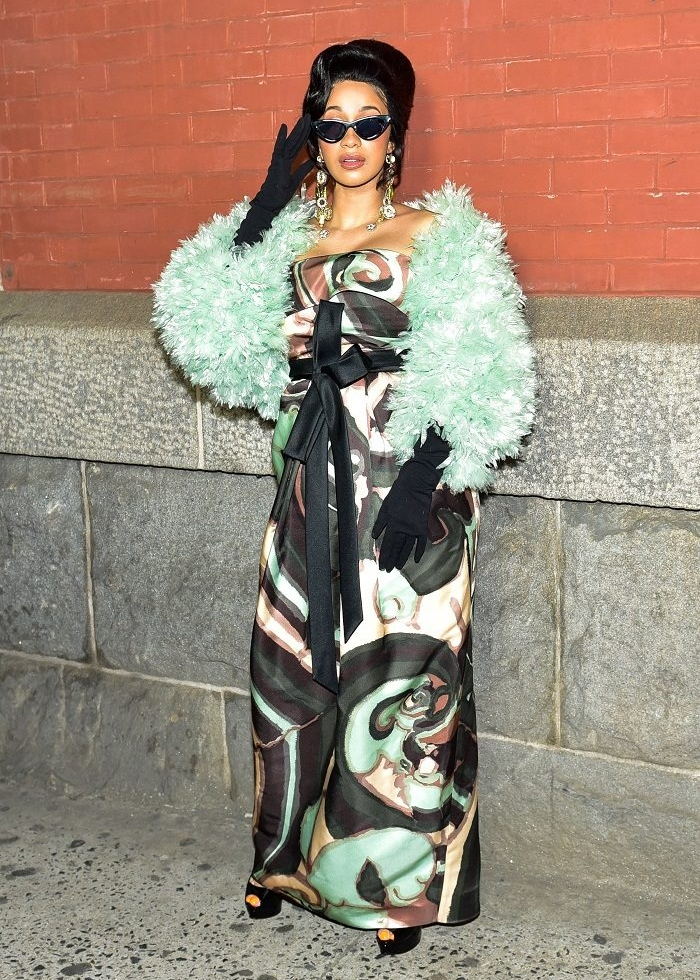 Cardi B showed out at the Marc Jacobs fashion show during NYFW, wearing a printed dress paired with a furry sea-foam green shawl.