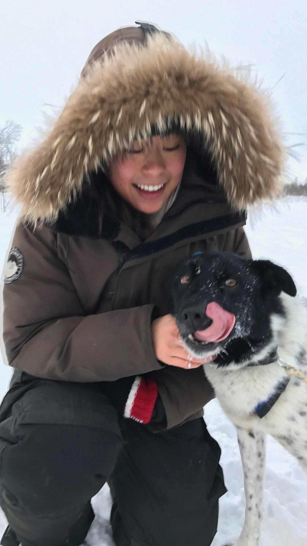 Dog girl, overjoyed to meet a real-life sled dog. Basically Balto.