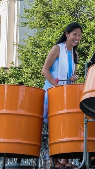 Me, cheesin, playing the tenor bass steel drums. You can't be sad while playing soca!