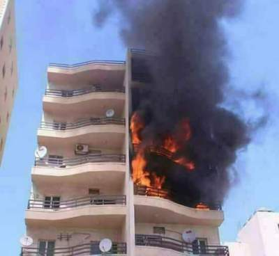 An apartment building full of civilians, struck by Turkish bombs or shells.