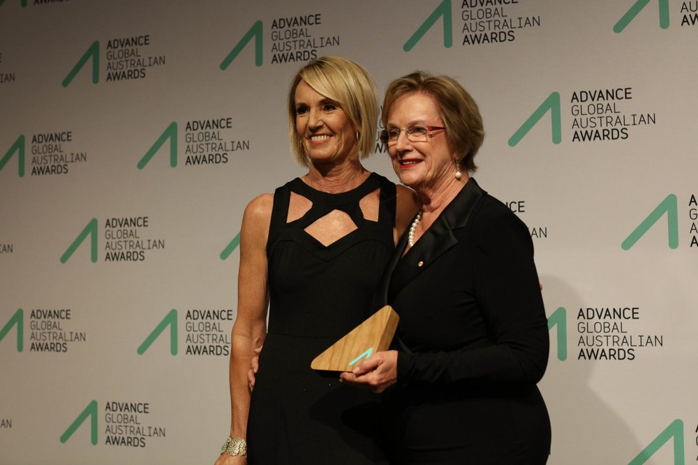 Virginia Harper receiving the Social Impact Award on behalf of her brother  Andrew  from Wendy McCarthy AO