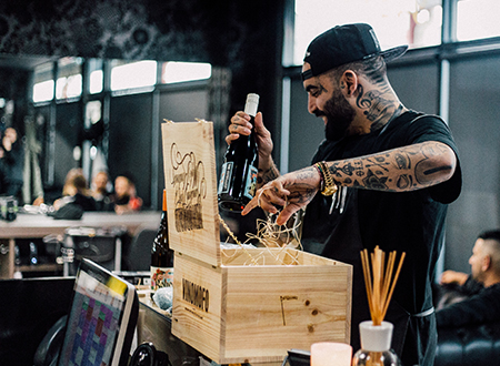 Vinomofo team member packs a case of wine for a customer.