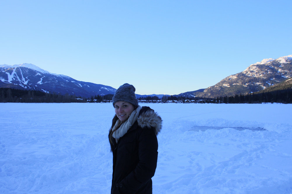 Whistler in the background. A very frozen green lake in the mid-ground and my ex in the foreground.