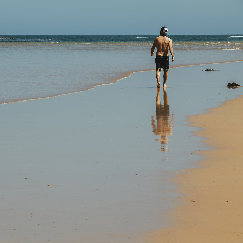 Strolling down the deserted beach and taking in the serenity.