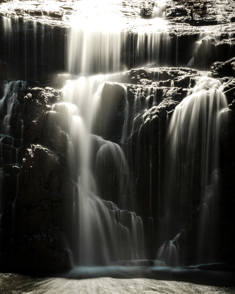 A Calming Feeling Sitting Below A Cascading Falls.