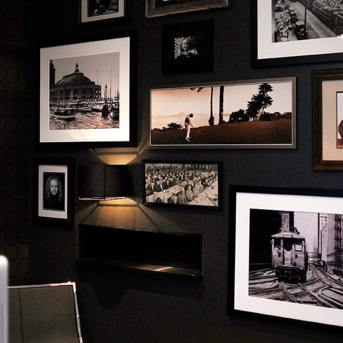 Black and whtie photography on a gallery wall painted black. Design by Jillian O'Neill.