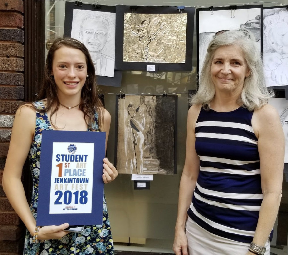 Elizabeth is pictured above alongside Mrs. Elena Cipolla, teacher of studio art at Martin Saints. Below, left: Martin Saints student submissions at the Festival; below, right: Elizabeth's winning drawing.