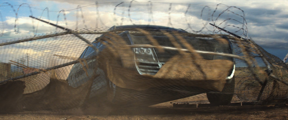This shot is also entirely CG. The limo and the fence are CG. Added dust and dirt elements.