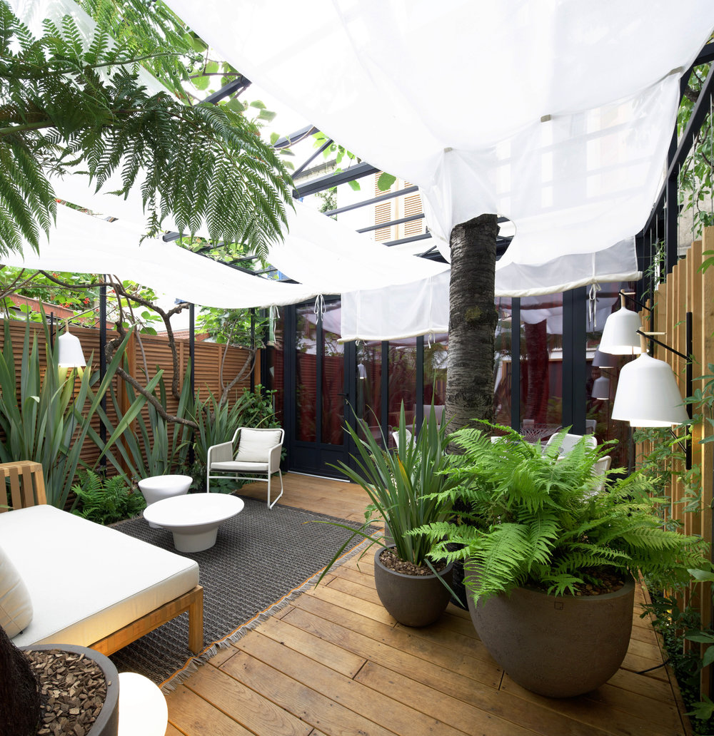 Exotic Garden, Paris   Nestled at the bottom of a small Parisian impasse is now an urban garden of 35 sq. meter with an exotic atmosphere. A particular attention to detail is provided to create intimacy and lush.