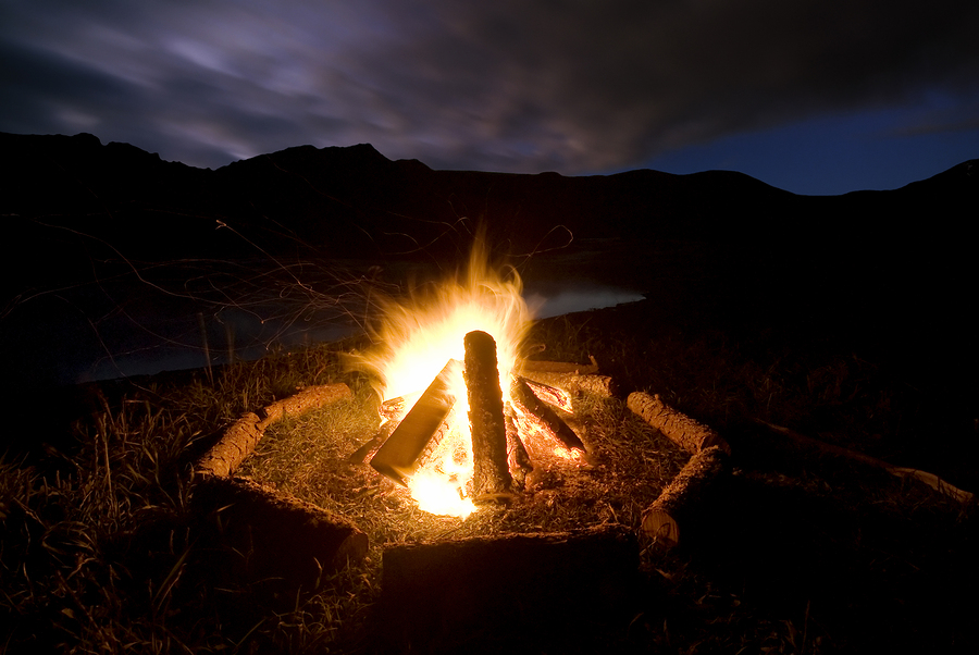 bigstock-Camp-fire-beside-lake-and-moun-43491331.jpg