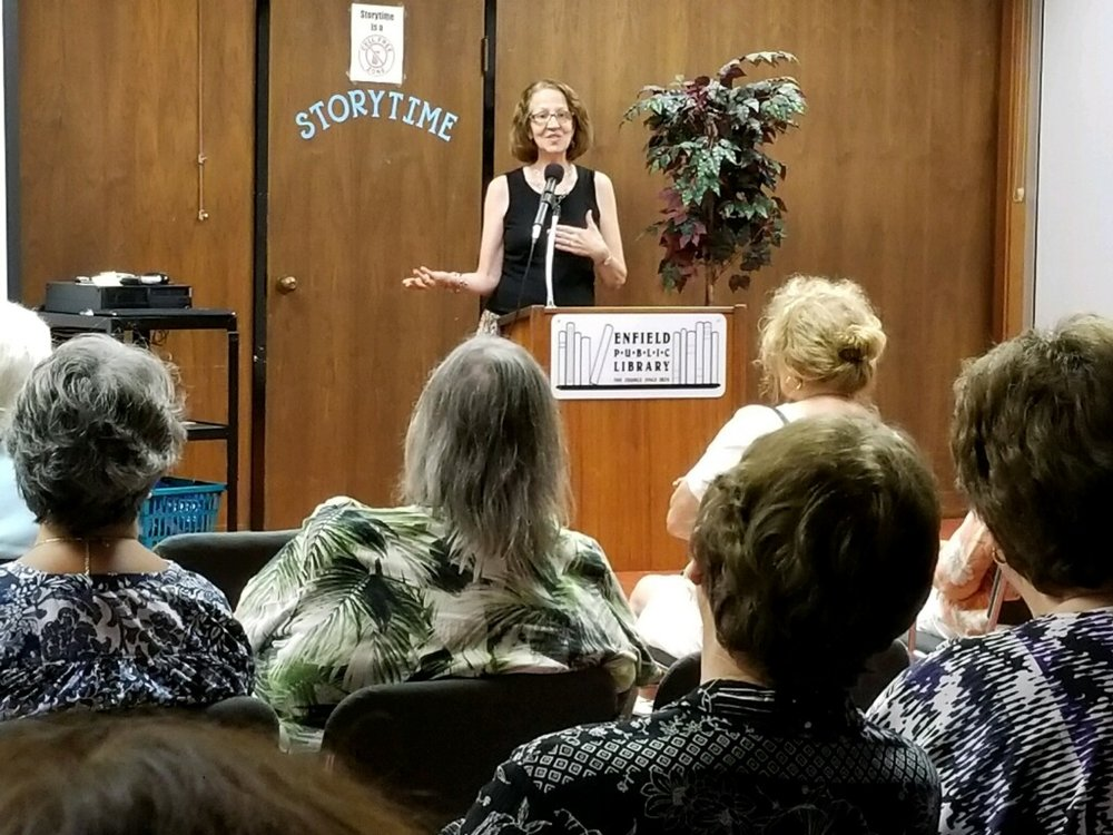 Karyl Evans speaking at a screening event for the Enfield Garden Club