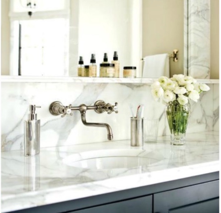 6. Counter & Backsplash transitions ~ photo via @atlantahomesmag - Break the status-quo and take that marble backsplash to new heights. These counter and backsplash transitions show off the true beauty of a stunning slab of marble by covering more surface area!