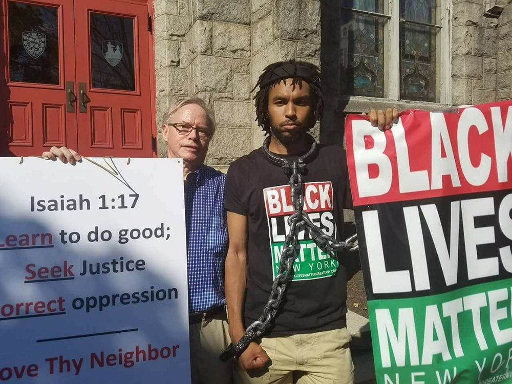This is a picture of Glenn Cantave, founder of Movers and Shakers of New York, and me on the steps of the church where we counter-demonstrated together on Sept. 16, 2017.