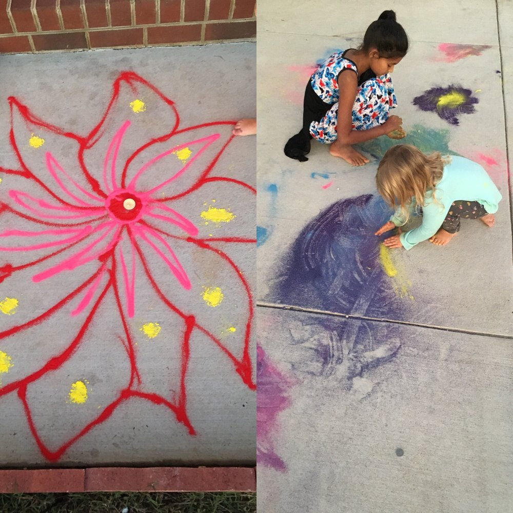 These two photos were   taken in a neighbor's drive way 10/19/2017 during the Hindu Festival of   Diwali. I love being part of a multi-cultural community now. My neighbors   invited our children over to help them decorate their drive way with sand   flowers. They later covered them in little tea light candles and lit them   once it was dark. It was so beautiful. They were also super patient, and   gracious. Even when my little ones wiped away some of the pretty flowers they   had made.