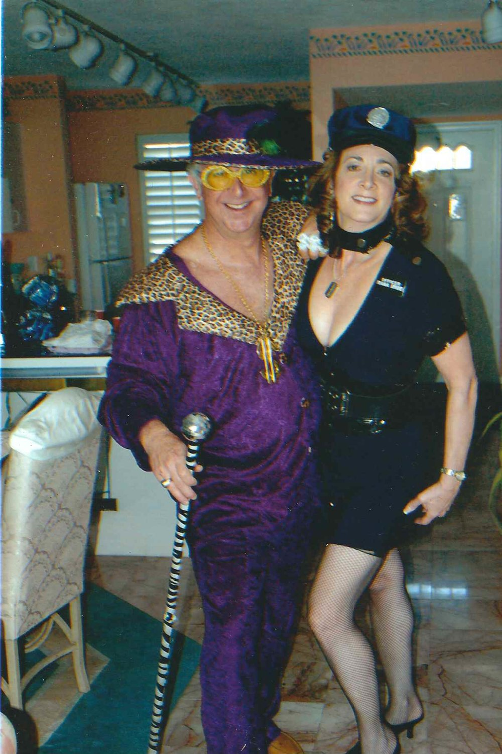 My bride and me appropriately dressed for Fantasy Fest in Key West. Couldn't send the   rest...just google it.