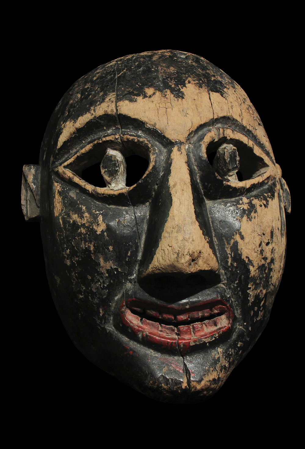 Iroquoian (Cherokee) Booger Mask, which portray and mock bad-mannered people. This early example was carved from eastern cedar (juniper) in the 18th Century. It was abandoned in Tennessee by its Cherokee owners on the Trail of Tears.