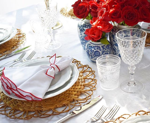 Kicking off MDW with this festive tablescape 🇺🇸 All it needs is some rosé to go with these roses! . . .  Mode Living Napa Napkins ($48): @neimanmarcus // Water Hyacinth Placemat ($7.99): @pier1 // Brilliant Cut Acrylic Goblet ($4.17) @pier1 // Acrylic Water Glasses: @bacimilano // Large ginger gars ($38 each) : @levillagemarche // Roses: @safeway // Plates and flatware: @williamssonoma