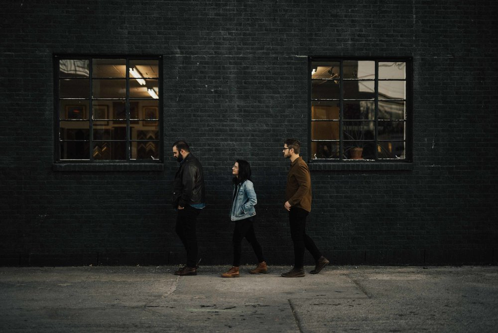 Cedar House band pic, taking a stroll in a line down an alley, acting like we don't know a camera is there
