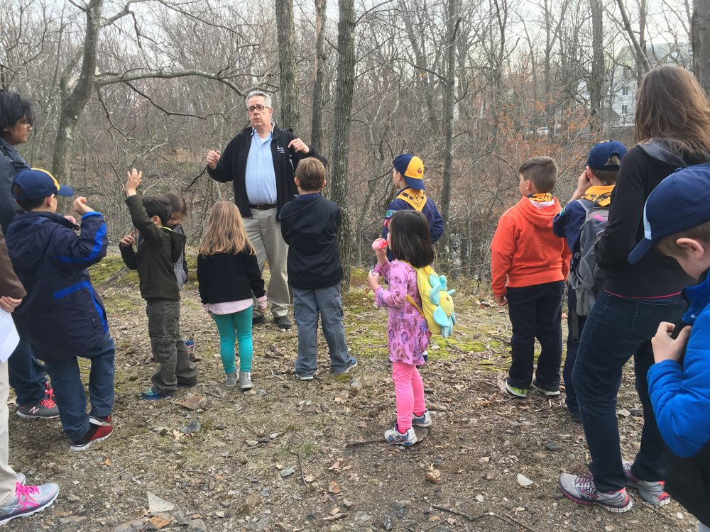 Bob Locke leading a cub scout hike at Green Hill Park in 2017.