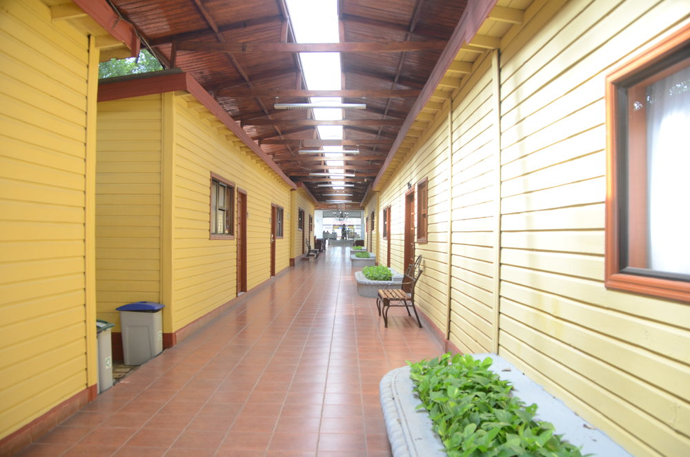 This is one of the many hallways in the hotels, each few rooms are like little houses. There are yards, and dividers, and a lot of outdoors all over.