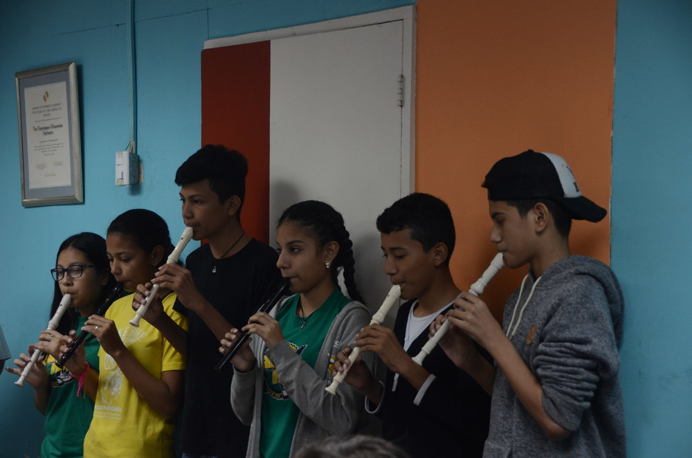 After the lunch there was music. The tall boy in the middle is the teacher for this recorder school. He's 15, he has done a great job of instructing them!