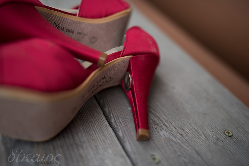 The sixpence attached to the heel of her heel!