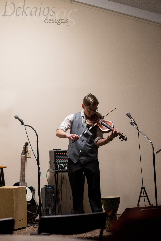My son at his violin recital ( I apologize it was so dark)