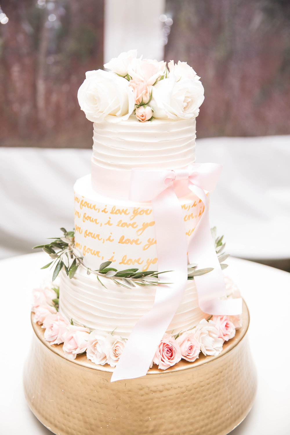 Two layers were vanilla cake with peanut butter mousse & white chocolate ganache and the other layer was vanilla cake with whipped strawberry buttercream!