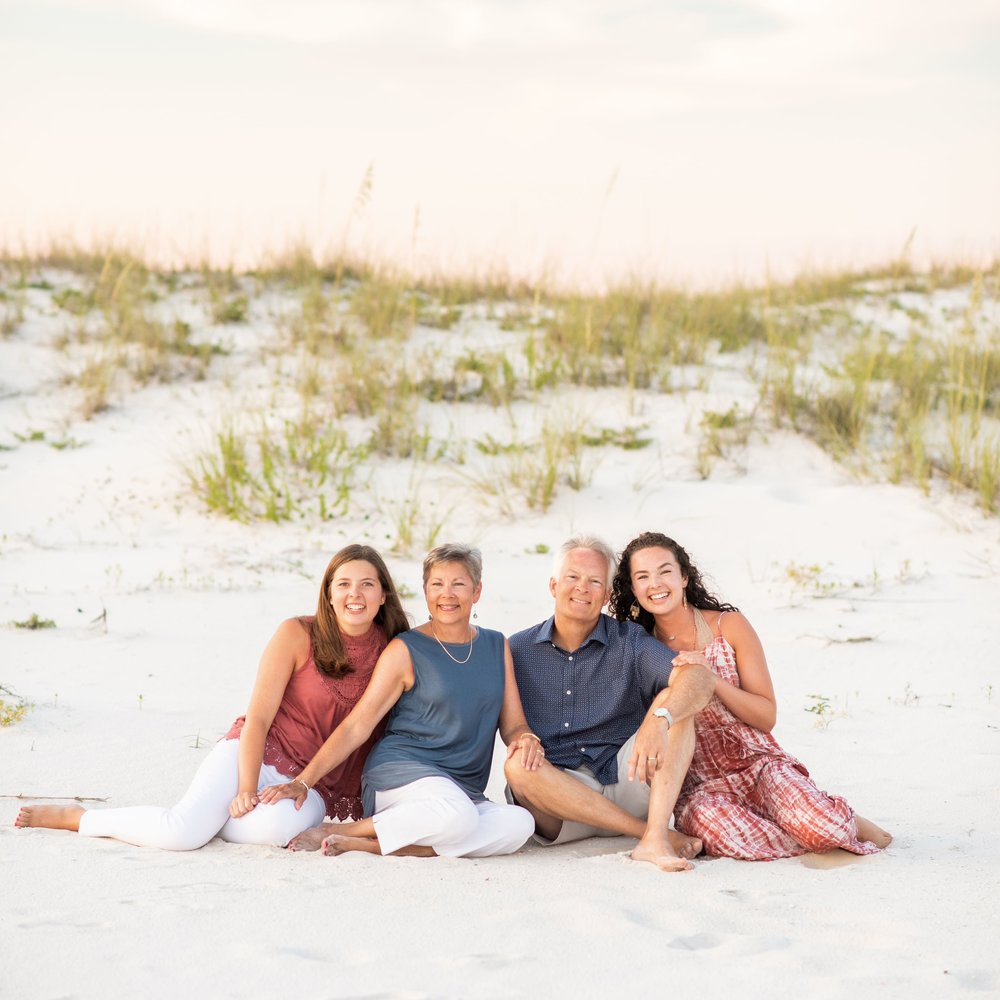 family beach portrait  in a pink sunset