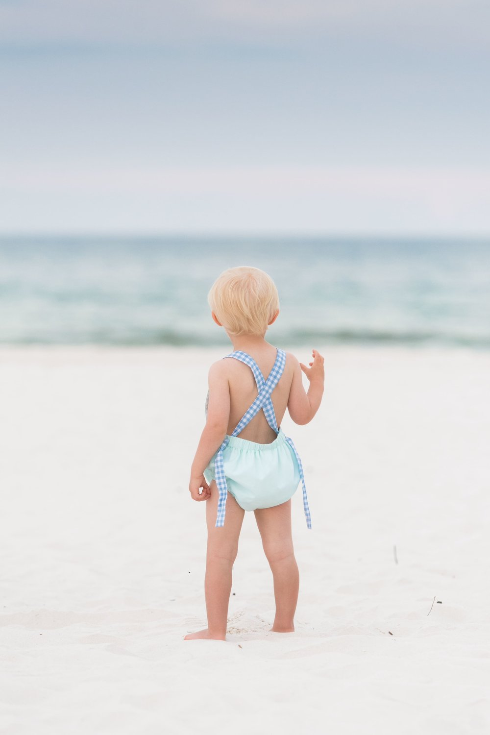 pensacola beach photographer captures a young toddler on the beach