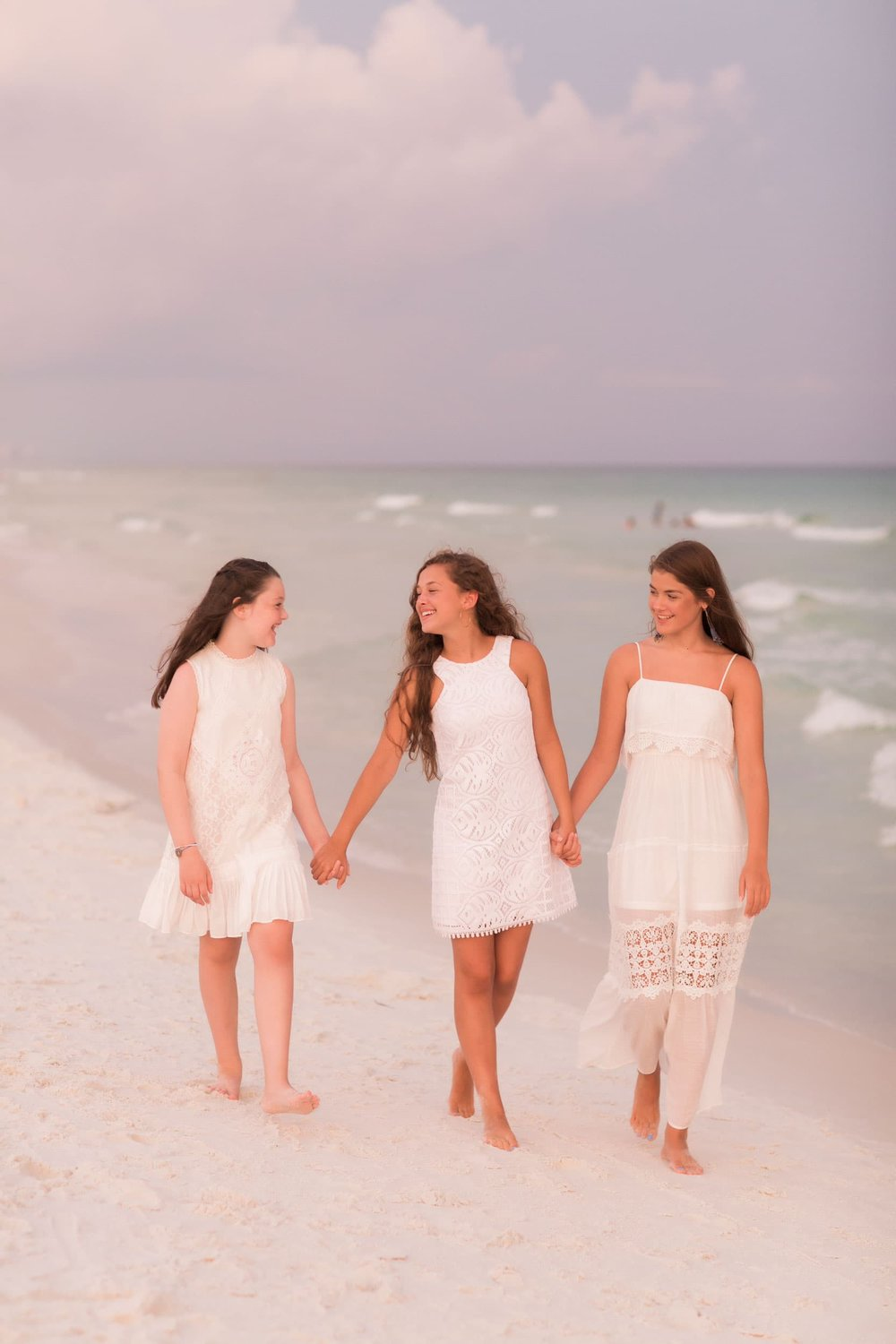 destin beach photographer session with young girl in beach 30A beach photo session