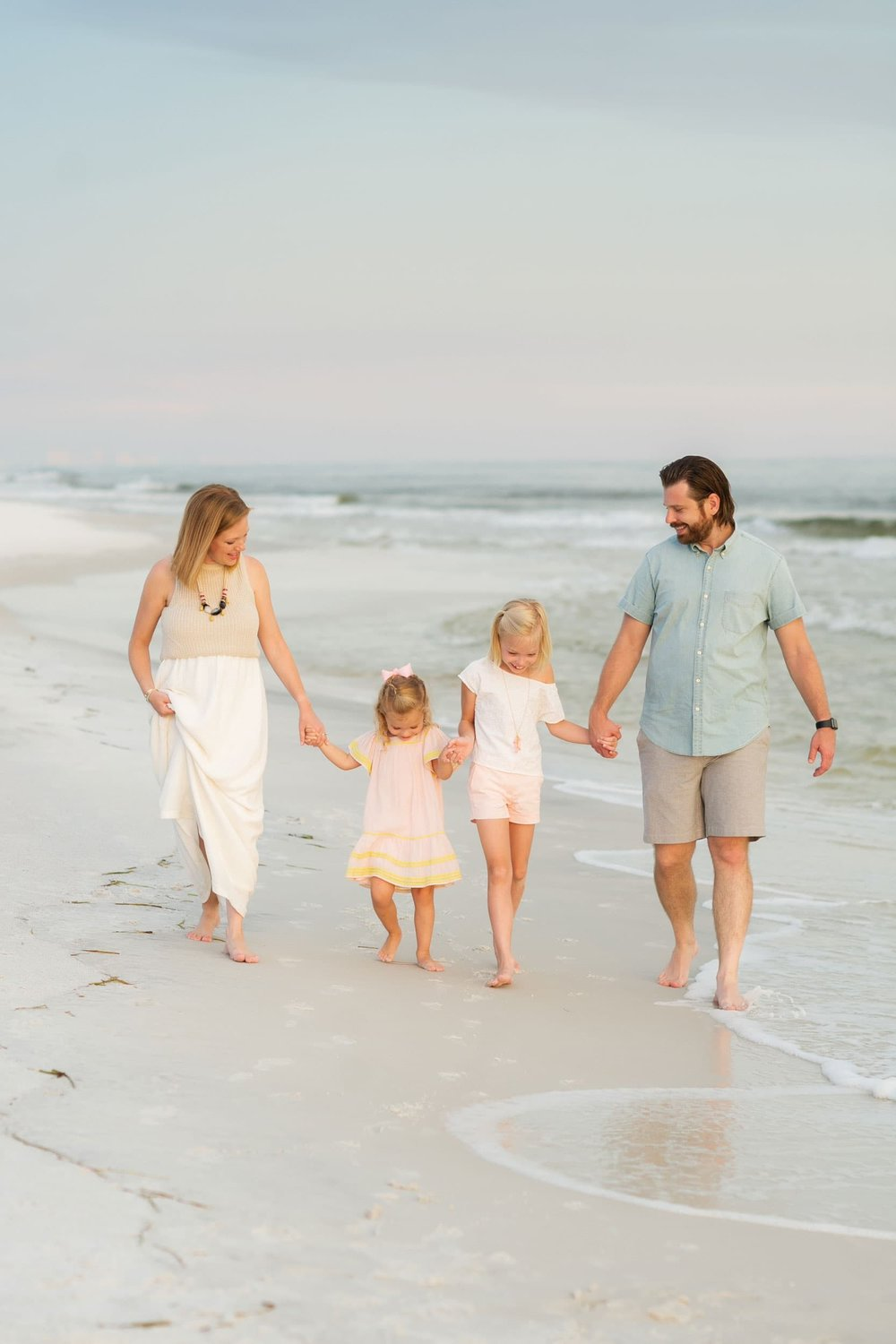 family on holiday in florida walks in the waves