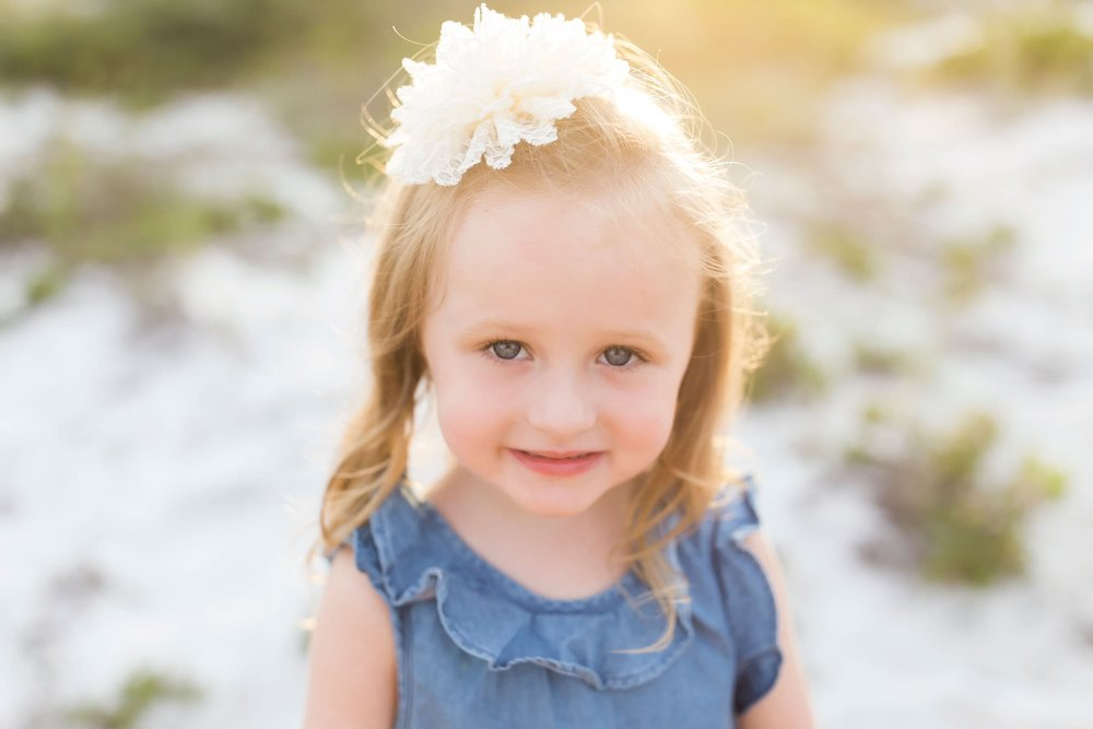 young girl smiles in wave photography picture