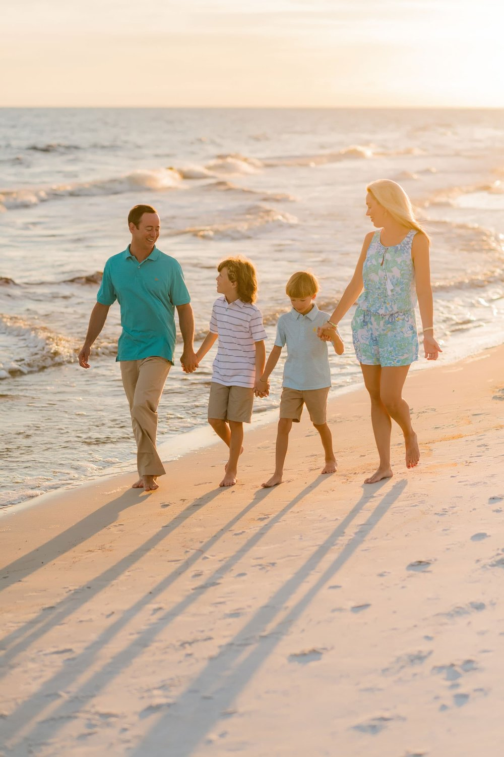 photo session in orange beach of family in sand