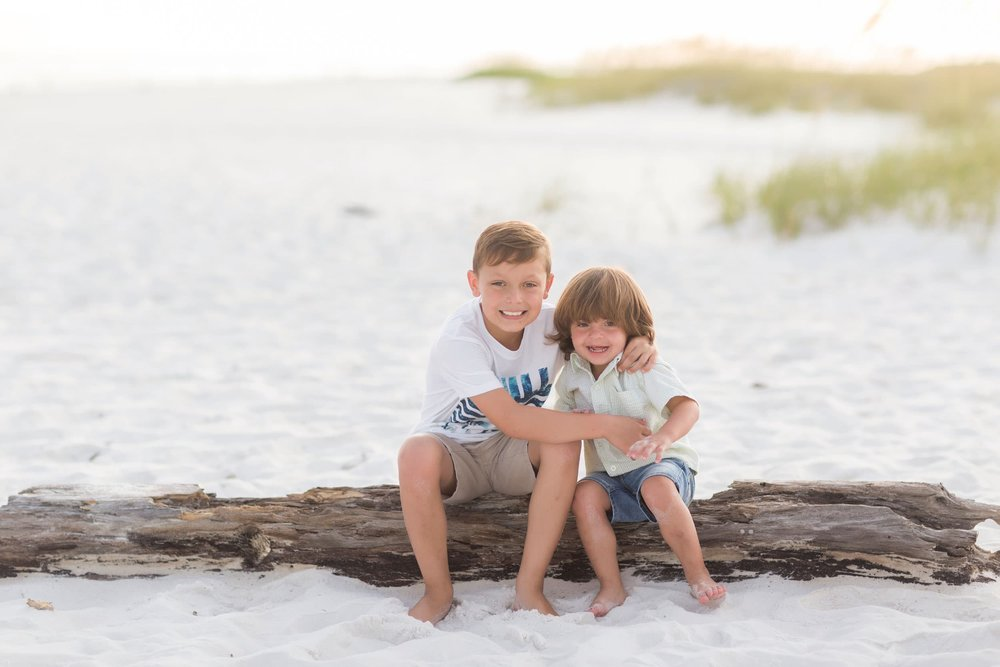 young brothers playing in the dunes in picture