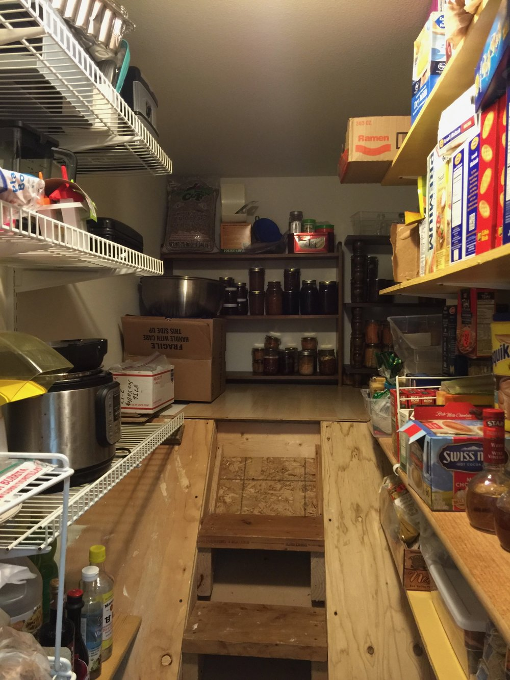 Everything is accessible now in this inventive above-the-stairs pantry.