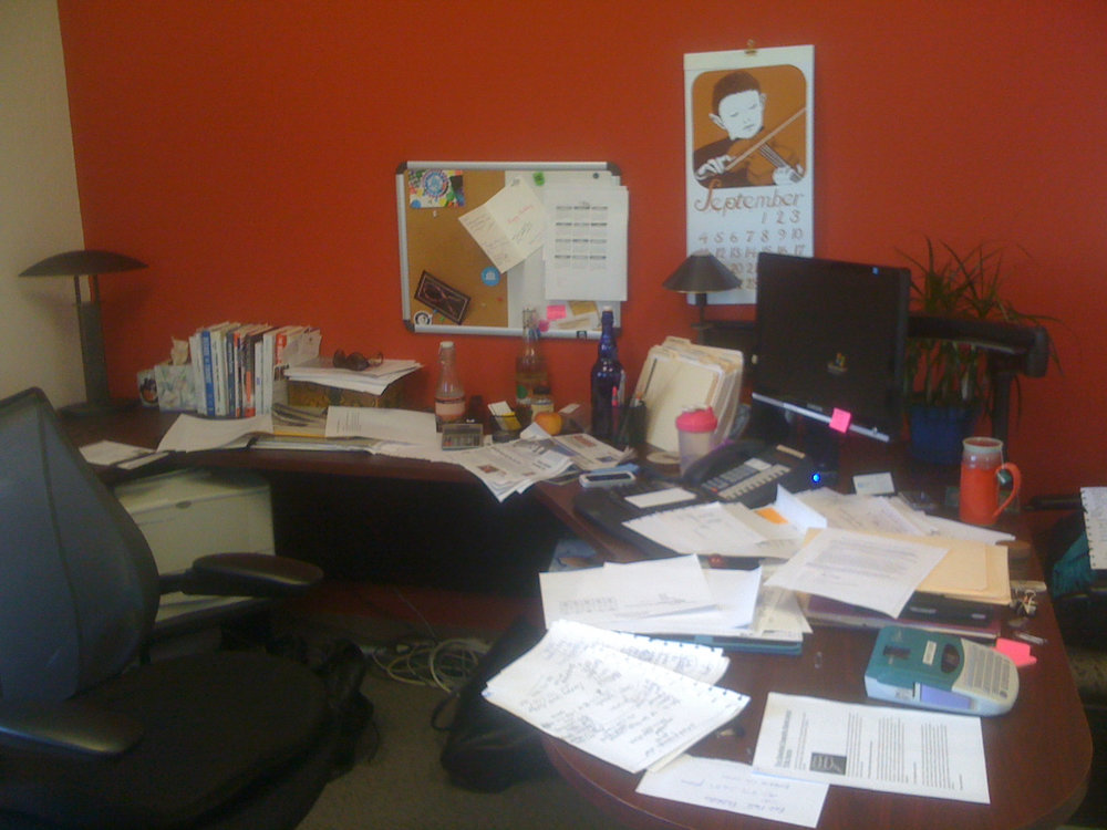Before... CEO's office. Busy, busy busy and time to reorganize.