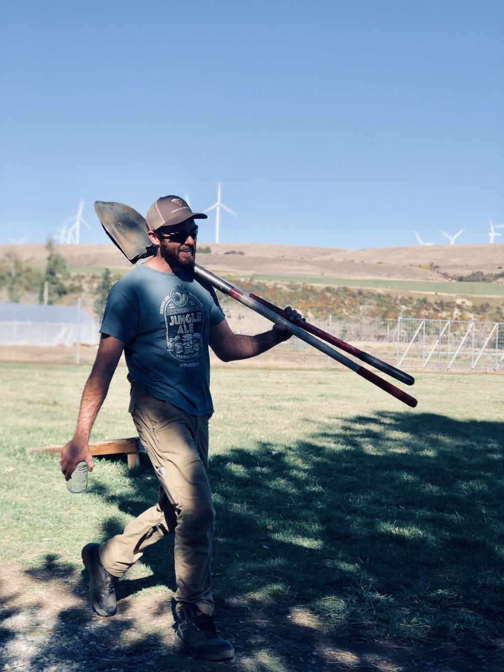 Sean carrying some shovels on a glorious October day at Spoon Full.