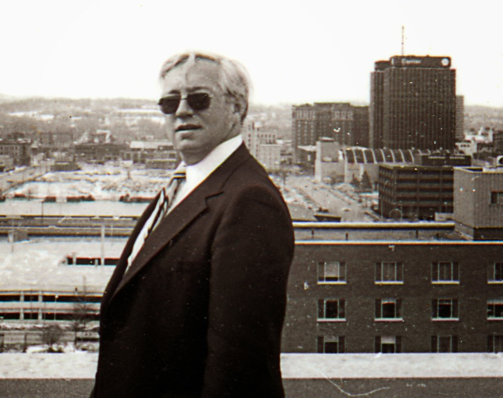 Dad in his prime and looking cool with his city in the background. Photo by Daniel Wilson Fay.